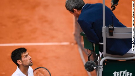 Novak Djokovic wasn't happy with chair umpire Carlos Ramos at the French Open on Friday after he was docked a serve and given an unsportsmanlike conduct warning.