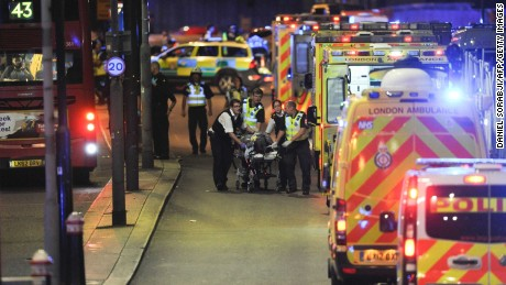 Police officers and members of the emergency services attend to a person injured in the June 3 attack on London Bridge.