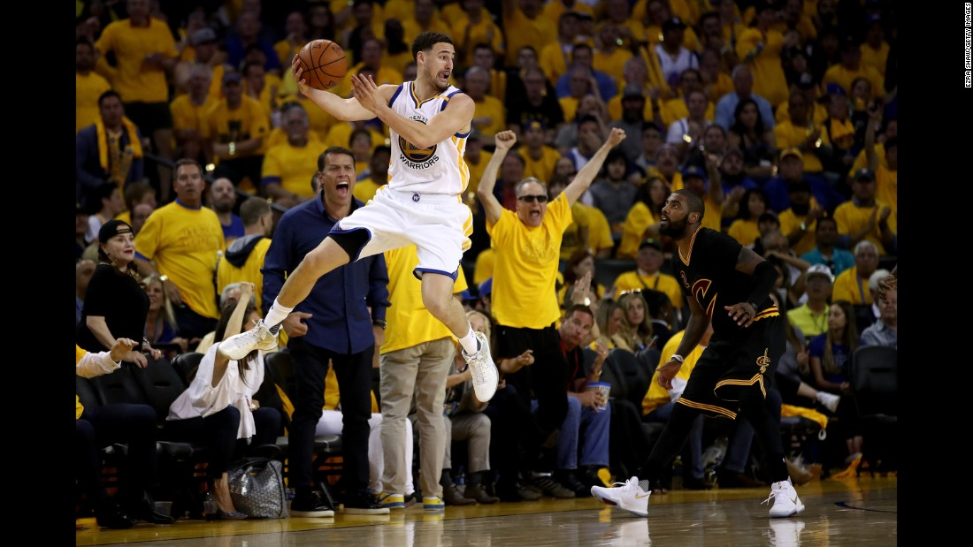 Klay Thompson looks to pass the ball in Game 2.