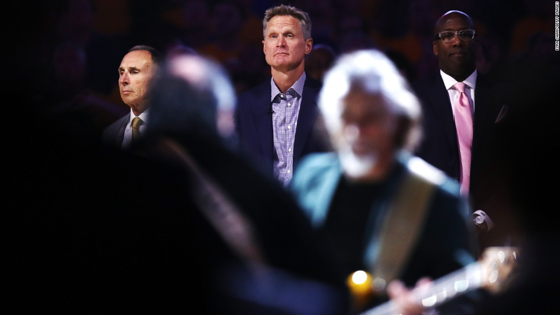 Kerr stands for the national anthem before Game 2. He had just returned to the Warriors bench for the first time since April. He took a leave of absence because of complications from his 2015 back surgery.