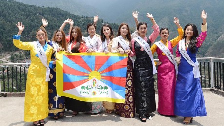 Nine contestants of the Miss Tibet Pageant 2017 pose for a photo during a press conference on 30 May 2017.