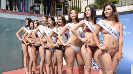 The nine contestants of the Miss Tibet Pageant 2017 pose for a photo during the Swimsuit Round at Asia Health Resorts in Dharamshala, India, on 2 June 2017.