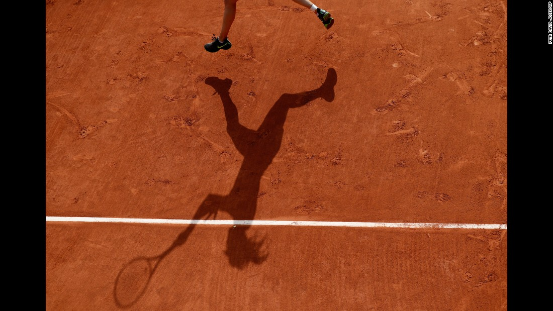 Eugenie Bouchard's shadow is seen on the Roland Garros clay as she plays her first-round match at the French Open on Tuesday, May 30.