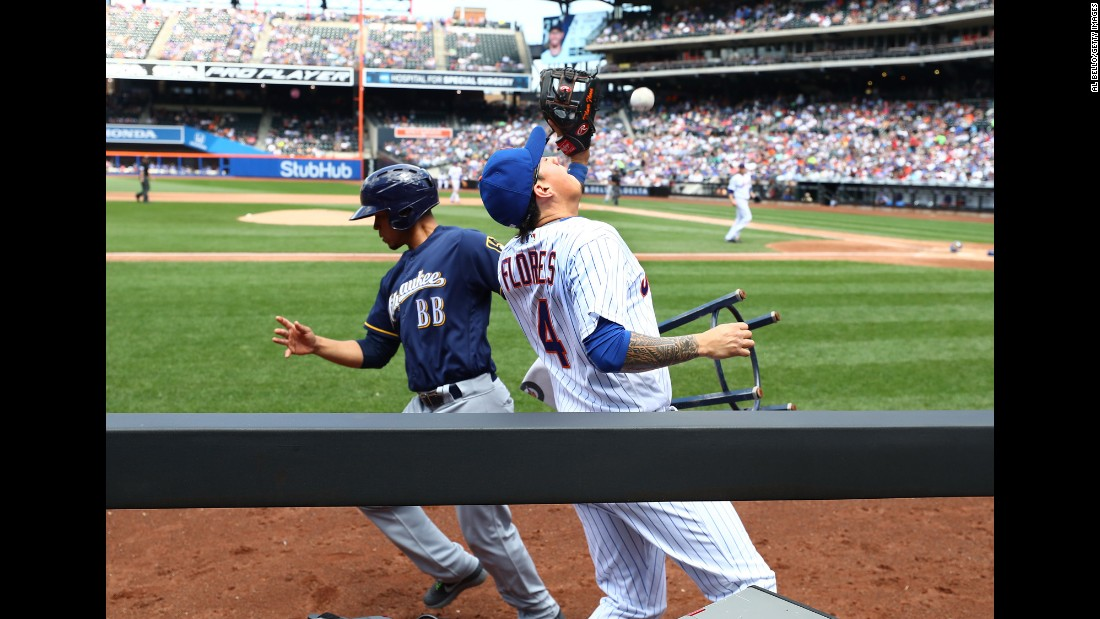 A batboy runs away from Wilmer Flores as the New York Mets infielder tries to catch a foul ball on Thursday, June 1. Flores was unable to make the catch. The ruling on the field was that there was no interference.