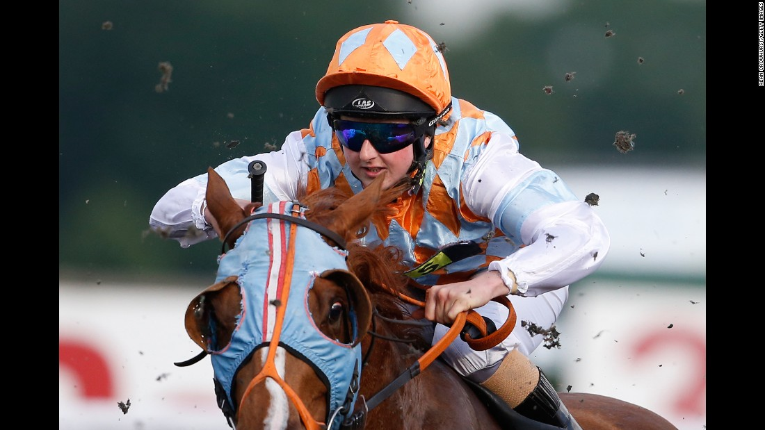 Jockey Gina Mangan rides at Kempton Park Racecourse in Sunbury, England, on Wednesday, May 31.