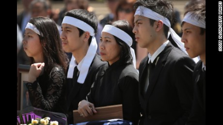 Myhanh Best, Ricky Best's wife, and their children attend a committal service  at Willamette National Cemetery on Monday.