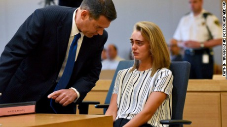 Attorney Joseph Cataldo talks to his client, Michelle Carter, before meeting at a side bar at the beginning of the court session at Taunton Juvenile Court in Taunton, Mass., on Monday, June 5, 2017.  Carter is charged with manslaughter for sending her boyfriend text messages encouraging him to kill himself.