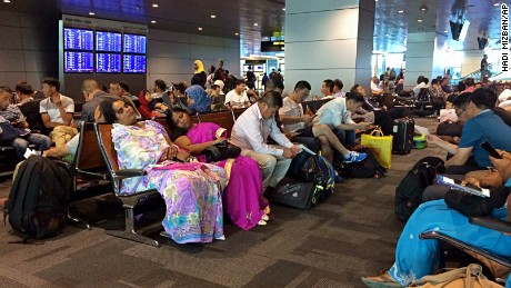 Passengers of cancelled flights wait on Tuesday, June 6, in Hamad International Airport in Doha, Qatar.