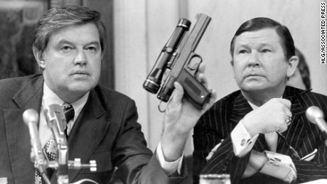 Committee Chairman Frank Church displays a poison dart gun during testimony about the CIA.