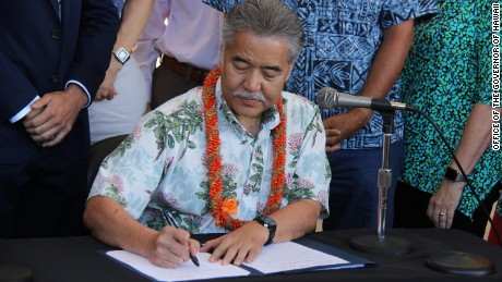 Hawaii Gov. David Ige signs laws aimed at reducing greenhouse gas emissions.
