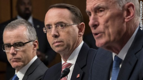 From left, acting FBI Director Andrew McCabe, Deputy Attorney General Rod Rosenstein, and Director of National Intelligence Dan Coats, testify before a Senate Intelligence Committee hearing about the Foreign Intelligence Surveillance Act, on Capitol Hill, Wednesday, June 7, 2017, in Washington. (AP Photo/J. Scott Applewhite)
