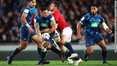 Sonny Bill Williams looks for an offload to unlock the Lions defence.