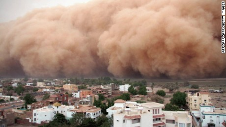 "KHARTOUM,SUDAN - APRIL 29:  A gigantic cloud of dust known as ""Haboob"" advances over Khartoum on 29 April 2007. These seasonal type of monsoons can reach a height of 3000 feet and can change the landscape in the few hours they last. (Photo by: AFP/Getty Images)"