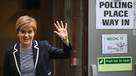 SNP Leader Nicola Sturgeon exits after casting her vote in the general election with her husband Peter Murrel.
