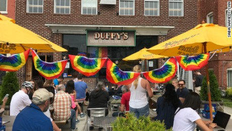 A crowd gathered outside Duffy's Irish Pub in Washington on Thursday June 8, 2017, for ousted FBI Director James Comey's testimony on the Hill.