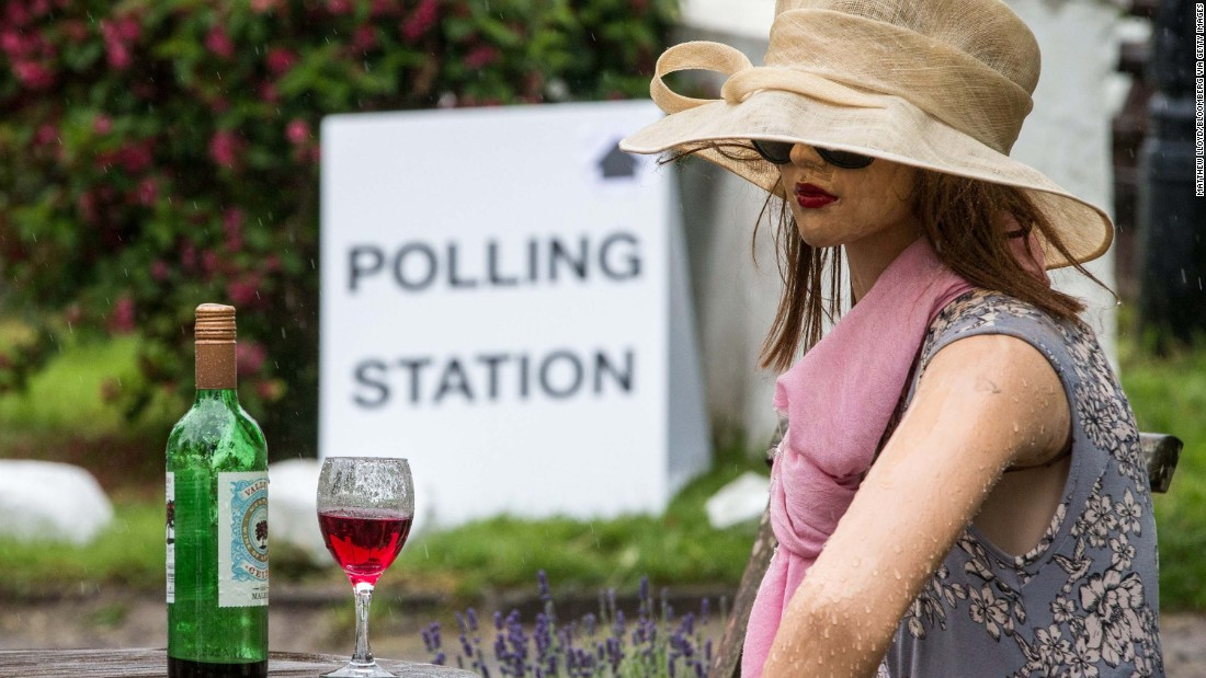 A mannequin sits on display outside a pub where a polling station was set up in Roecliffe, England.