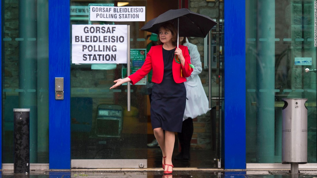 Leanne Wood, leader of the party Plaid Cymru, leaves a polling station after voting in Rhondda, Wales.