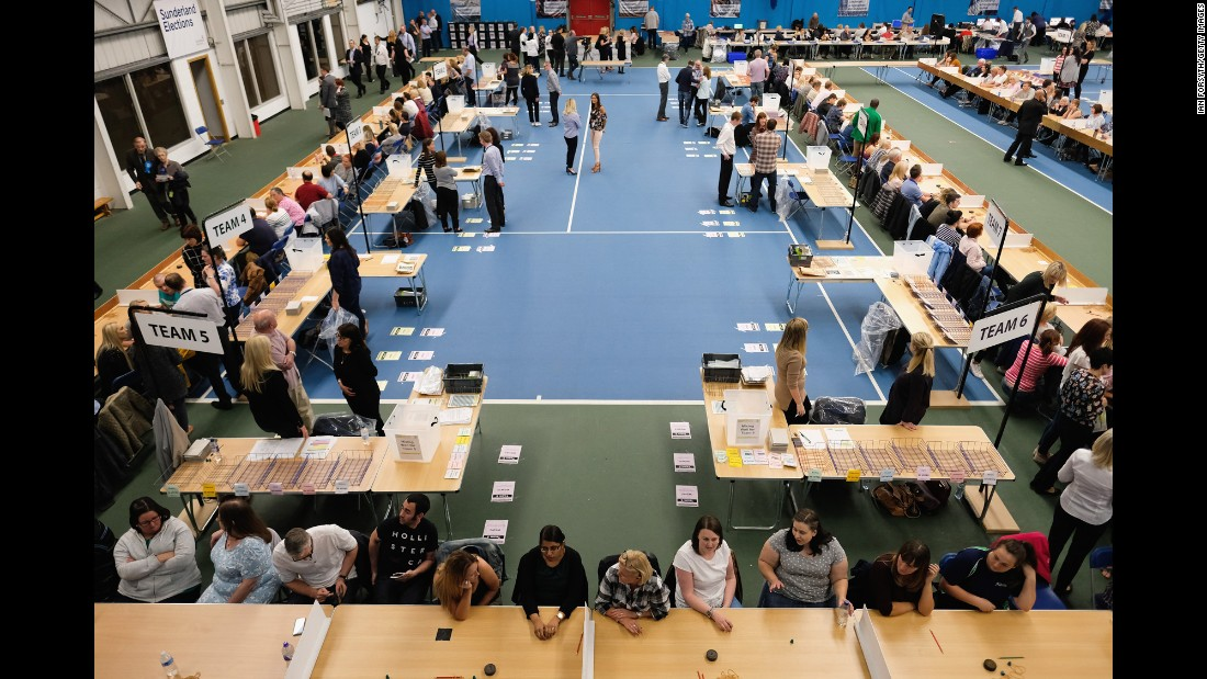 Election staff take their seats before counting votes in Sunderland, England.