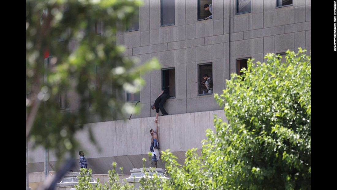 "Police help civilians escape the Parliament building in Tehran, Iran, on Wednesday, June 7, during twin attacks. At least 12 people were killed when six attackers mounted <a href=""http://www.cnn.com/2017/06/07/middleeast/iran-parliament-shooting/index.html"" target=""_blank"">simultaneous gun and suicide bomb assaults</a> on Iran's Parliament building and the tomb of the republic's revolutionary founder, in one of the most audacious assaults to hit Tehran in decades. Iran's Revolutionary Guards said Saudi Arabia supported ISIS in the deadly twin attacks."
