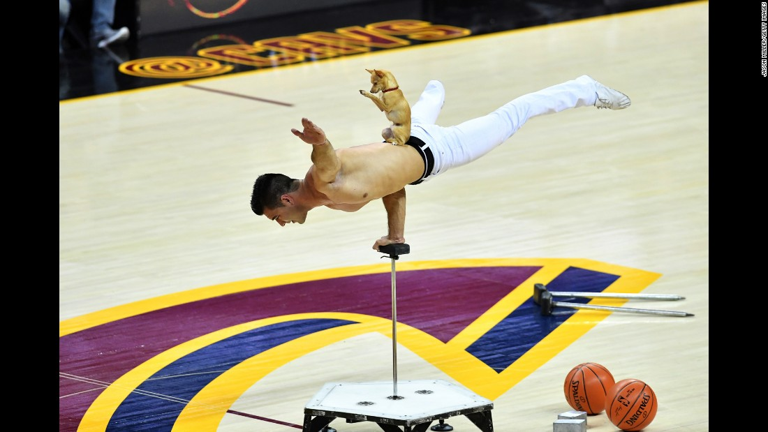 A man performs during the halftime show of Game 3 of the NBA Finals in Cleveland on Wednesday, June 7. The Golden State Warriors defeated the Cleveland Cavaliers 118-113.