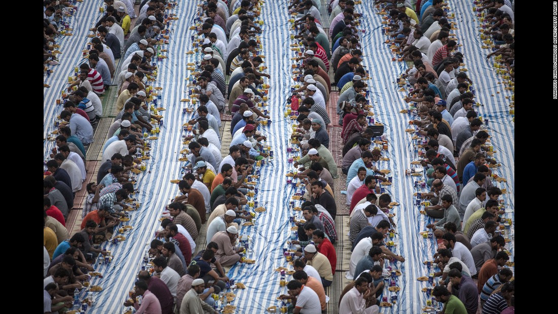 Muslims attend Iftar dinner during the holy month of Ramadan in Dubai, United Arab Emirates, on Monday, June 5. Iftar is the first meal eaten by Muslims after sunset during Ramadan.