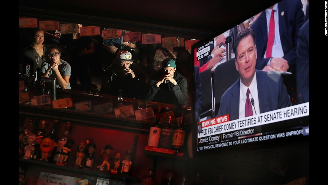 "People at Ace's Bar in San Francisco watch a television broadcast of former FBI Director James Comey as he <a href=""http://www.cnn.com/2017/06/08/politics/james-comey-testimony-donald-trump/index.html"" target=""_blank"">testifies before the Senate intelligence committee</a> on June 8. Bars and restaurants across the nation opened early for communal watching. <a href=""http://www.cnn.com/2017/06/08/politics/comey-hearing-viewing-parties-reaction/index.html"" target=""_blank"">Comey testimony: In bars, at work and in pajamas, the nation watches</a>"