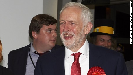 A smiling Jeremy Corbyn arrives at the count center in north London.