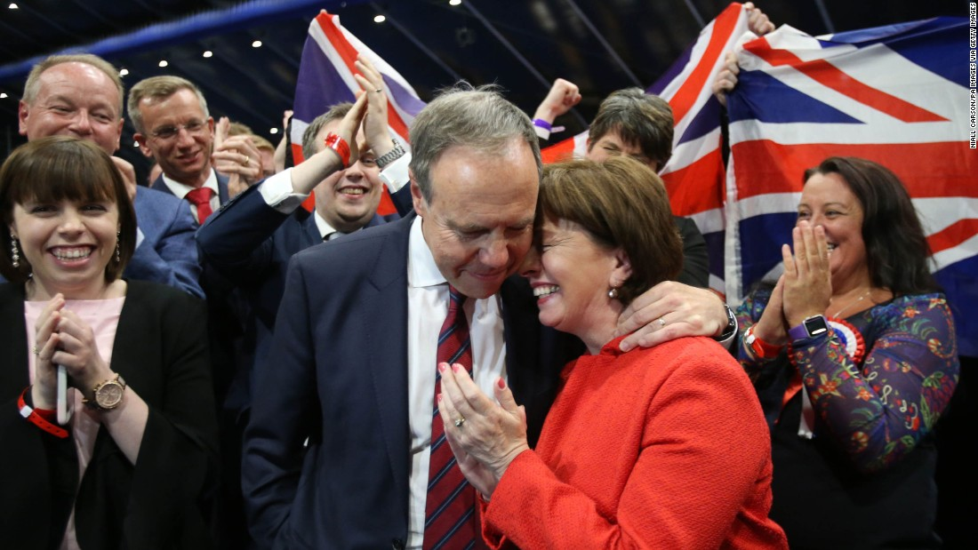 Nigel Dodds, deputy leader of Northern Ireland's Democratic Unionist Party, embraces his wife, Diane, following his election in Belfast. The conservative, pro-union party only gained two seats, but with May's Conservative Party short of a majority, the DUP has become disproportionately important in forming a new government.