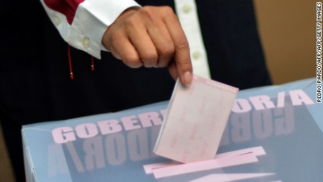 Mexico State candidate for governor for the National Regeneration Movement (MORENA) Delfina Gomez, votes at a polling station in Texcoco, Mexico State on June 4, 2017, during state election. Mexico's ruling party risks humiliation Sunday in President Enrique Pena Nieto's home state in a gubernatorial vote that could give a giant boost to leftist presidential hopeful Andres Manuel Lopez Obrador. / AFP PHOTO / PEDRO PARDO        (Photo credit should read PEDRO PARDO/AFP/Getty Images)