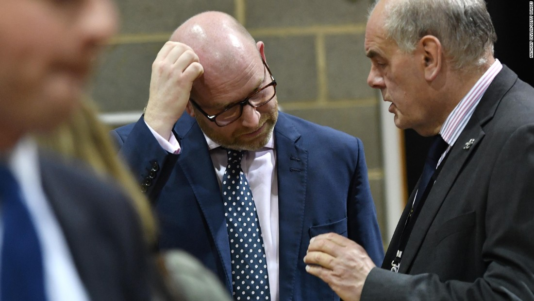 UK Independence Party leader Paul Nuttall, center, speaks with a party member following the vote count. Nuttall resigned later, leaving UKIP seeking its third leader in a year.