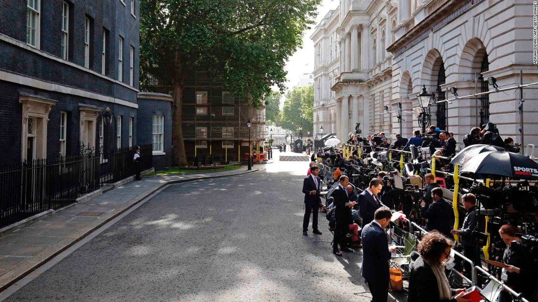 "Members of the press wait for May outside 10 Downing Street. May's Conservative Party won 318 seats -- short of the 326 needed for a majority and <a href=""http://money.cnn.com/2017/06/08/news/economy/uk-election-brexit-delay/index.html"" target=""_blank"">weakening May's position in upcoming Brexit talks.</a>"