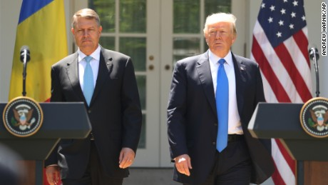 President Donald Trump, accompanied by Romanian President Klaus Werner Iohannis, walk to the dais to begin a news conference in the Rose Garden at the White House, Friday, June 9, 2017, in Washington. (AP Photo/Andrew Harnik)