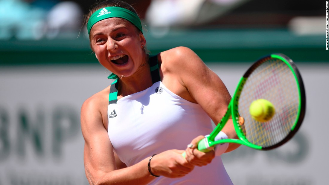 Jelena Ostapenko hits a two-hand return.
