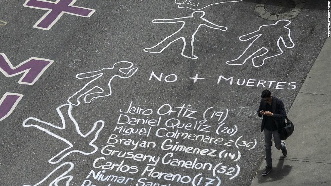 A street in eastern Caracas is painted with the names of people killed during more than two months of protests.