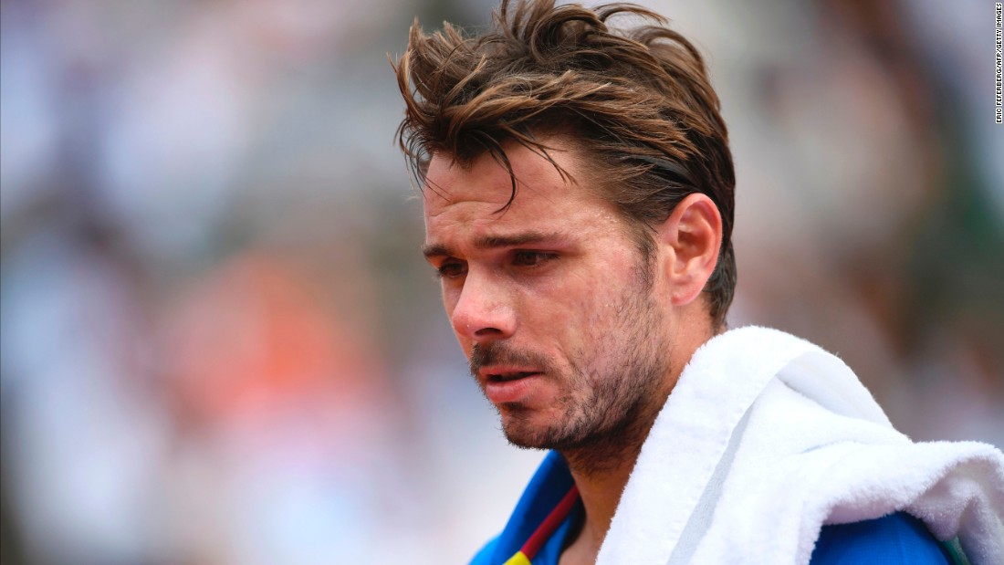 Wawrinka reacts during the men's final against Nadal at the French Open on Sunday.