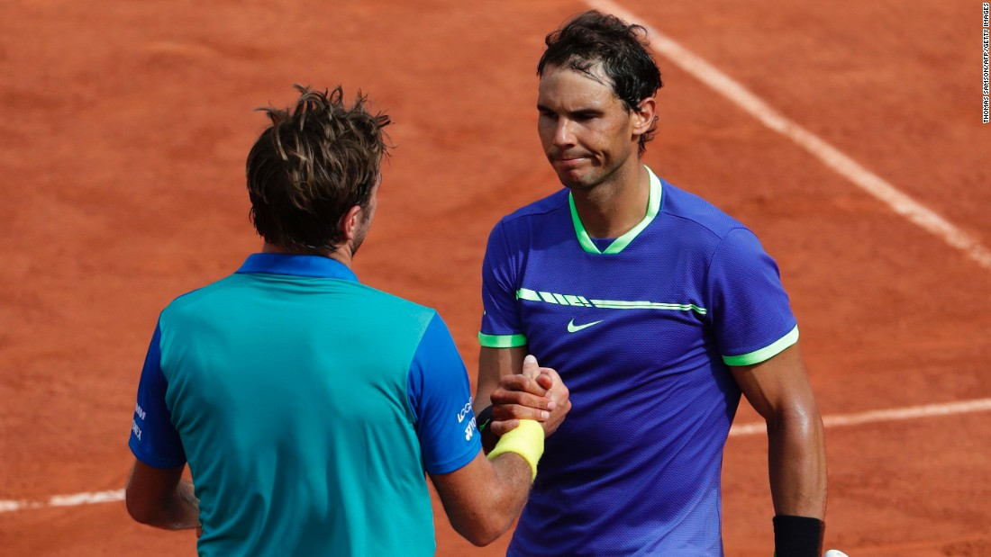 Nadal shakes hands with Wawrinka following their match at Roland Garros.