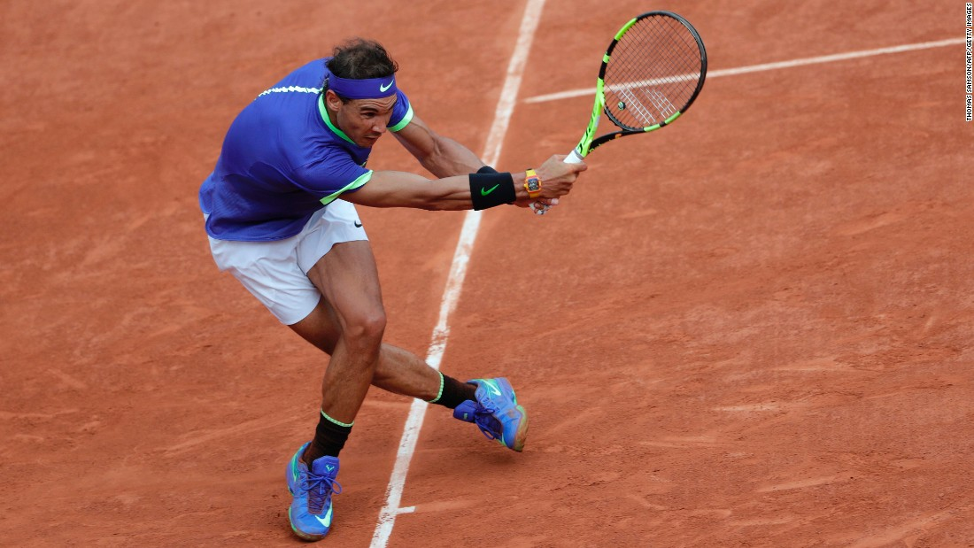 Nadal hits one of many returns during his  6-2 6-3 6-1 victory.