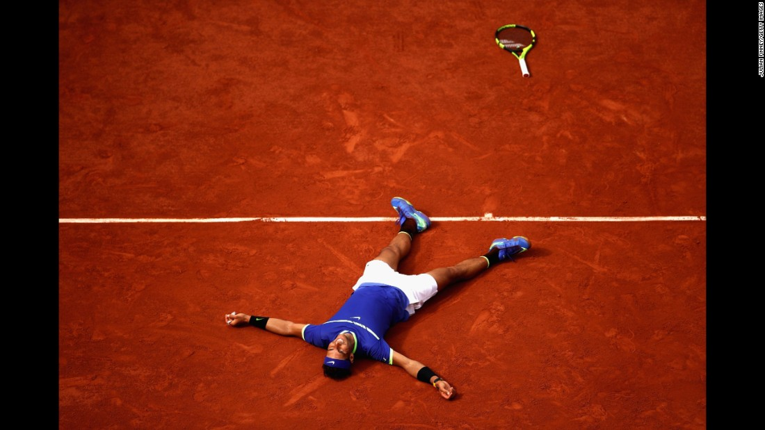 Spain's Rafael Nadal celebrates victory in the men's singles final against Stan Wawrinka of Switzerland at Roland Garros in Paris on June 11, 2017. The win meant Nadal claimed his 10th French Open title.