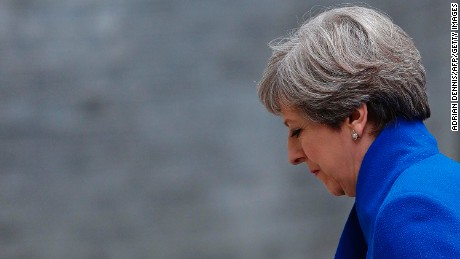 Britain's Prime Minister and leader of the Conservative Party Theresa May returns to 10 Downing Street in central London on June 9, 2017 after making a statement following the as results of a snap general election.