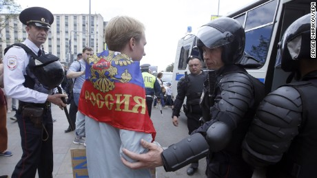 Police detain a participant of an unauthorized rally in Moscow's Tverskaya Street.