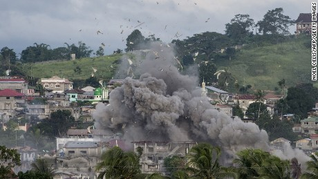 A bomb explodes after being dropped on an Islamist militants' hideout in Marawi, on the southern Philippine island of Mindanao on June 9, 2017.