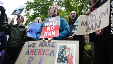 People protest outside as the 9th US Circuit Court of Appeals prepares to hear arguments on US President Donald Trump's revised travel ban in Seattle, Washington on May 15, 2017.