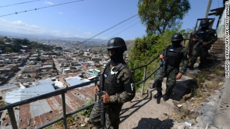 "Honduras' Military Police carries out a raid in Tegucigalpa, on February 24, 2017 as part of Morazan Operation to combat organized crime and insecurity in the country. Protesters and journalists risk falling afoul of new anti-terror laws passed in Honduras this week as part of a tougher government crackdown on vicious gangs. The changes designate as a terrorist act any form of ""illegal association"" and any act designed to ""intimidate or cause terror or force the state and international organization to make some sort of action.""  / AFP / Orlando SIERRA        (Photo credit should read ORLANDO SIERRA/AFP/Getty Images)"