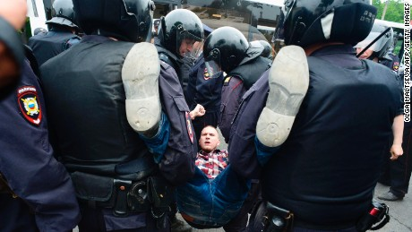 Police arrest a protester in St Petersburg.