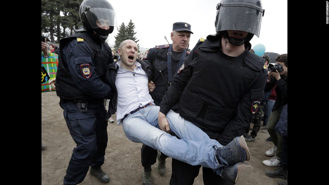 Police detain a protester during anti-corruption rally in St. Petersburg.