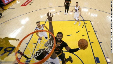 OAKLAND, CA - JUNE 12:  Kyrie Irving #2 of the Cleveland Cavaliers goes up for a shot against Draymond Green #23 of the Golden State Warriors in Game 5 of the 2017 NBA Finals at ORACLE Arena on June 12, 2017 in Oakland, California. NOTE TO USER: User expressly acknowledges and agrees that, by downloading and or using this photograph, User is consenting to the terms and conditions of the Getty Images License Agreement.  (Photo by Ezra Shaw/Getty Images)