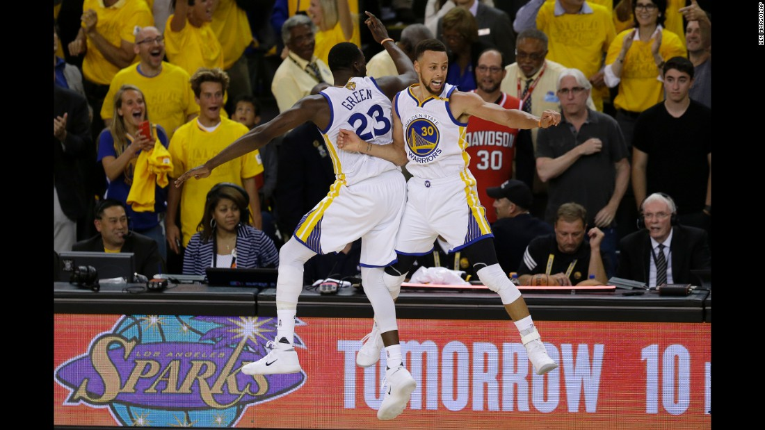 Golden State teammates Draymond Green and Stephen Curry celebrate late in the fourth quarter.