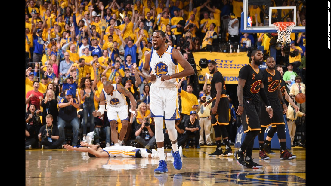 Kevin Durant, center, celebrates at the end of Game 5. This was the first title for Durant, who signed with the Warriors before this season. He was named the Finals' Most Valuable Player.
