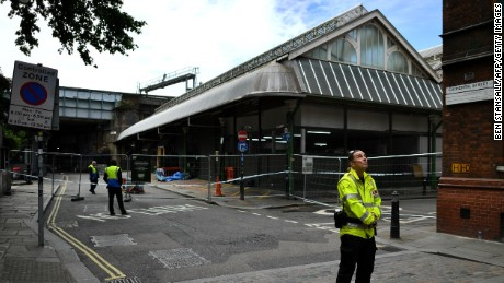 A security guard stands at a cordon at an entrance to Borough Market on Sunday.