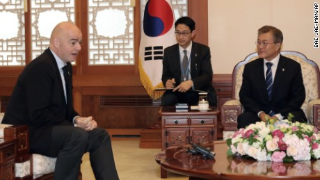South Korean President Moon Jae-in, right, talks with FIFA President Gianni Infantino at the presidential Blue House in Seoul, South Korea.